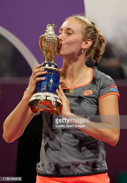 Elise Mertens of Belgium celebrates with the trophy following the Women's Singles Final match against Simona Halep of Romania during day six of the...
