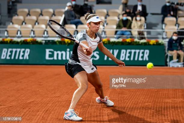 Elise Mertens of Belgium hits a forehand against Caroline Garcia of France in the third round of the women's singles at Roland Garros on October 02,...
