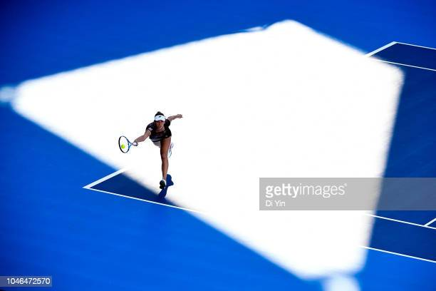 Elise Mertens of Belgium hits a return against Andrea Sestini Hlavackova and Barbora Strycova of Czech Republic with her teammate Demi Schuurs of the...