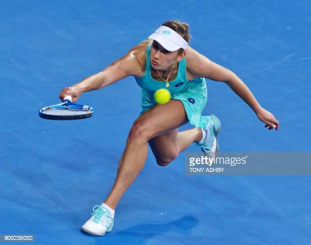 TOPSHOT Elise Mertens of Belgium hits a return against Angelique Kerber of Germany during their fourth session women's singles match on day three of...