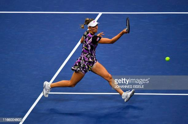 Elise Mertens of Belgium hits a return against Bianca Andreescu of Canada during their Women's Singles Quarterfinals match at the 2019 US Open at the...