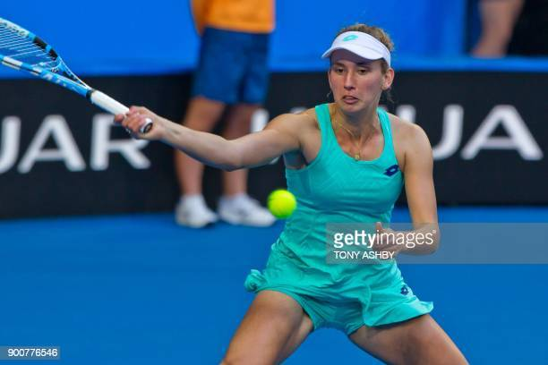 Elise Mertens of Belgium hits a return against Daria Gavrilova of Australia during their eighth session women's singles match on day five of the...