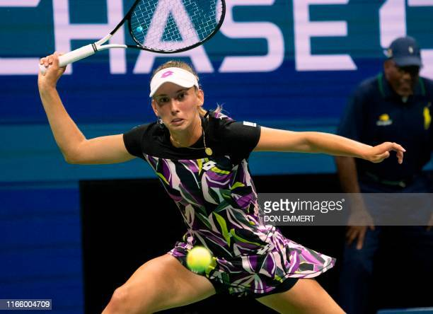 Elise Mertens of Belgium hits a return to Bianca Andreescu of Canada during their Quarterfinals Women's Singles match at the 2019 US Open at the USTA...