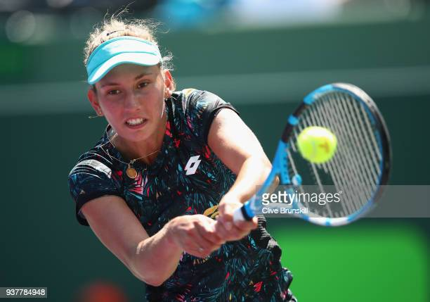 Elise Mertens of Belgium plays a backhand against Johanna Konta of Great Britain in their third round match during the Miami Open Presented by Itau...