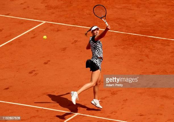 Elise Mertens of Belgium plays a backhand during her ladies singles third round match against Anastasija Sevastova of Latvia during Day six of the...