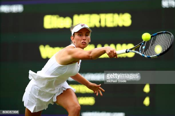 Elise Mertens of Belgium plays a backhand during the Ladies Singles first round match against Venus Williams of the United States on day one of the...