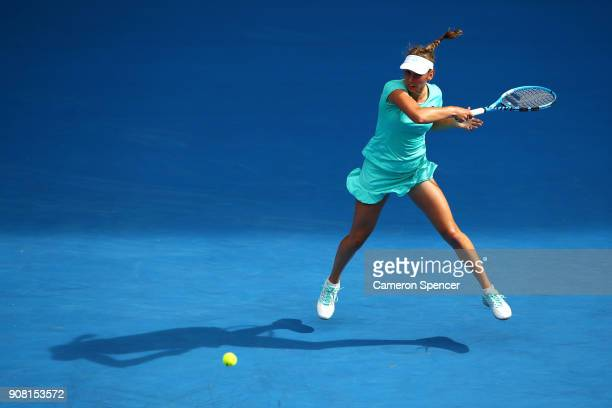 Elise Mertens of Belgium plays a backhand in her fourth round match against Petra Martic of Croatia on day seven of the 2018 Australian Open at...