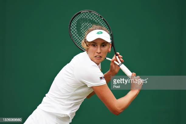 Elise Mertens of Belgium plays a backhand in her Ladies' Singles First Round match against Harriet Dart of Great Britain during Day Two of The...