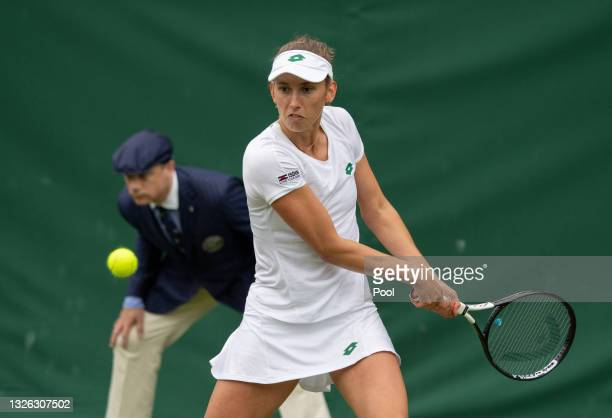 Elise Mertens of Belgium plays a backhand in her Ladies' Singles Second Round match against Lin Zhu of China during Day Three of The Championships -...