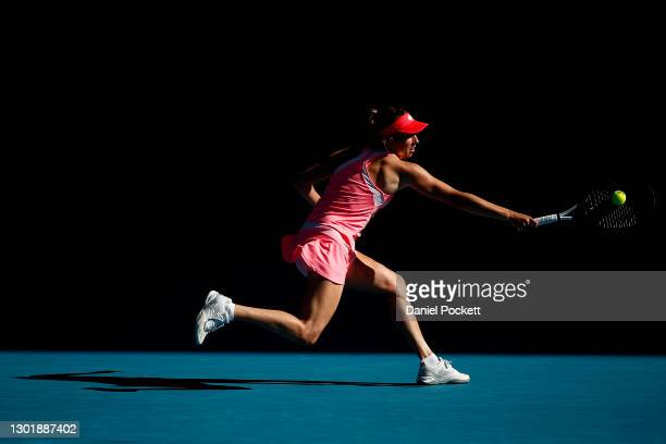 Elise Mertens of Belgium plays a backhand in her Women's Singles third round match against Belinda Bencic of Switzerland during day six of the 2021...