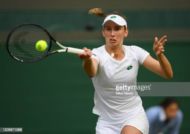 Elise Mertens of Belgium plays a forehand during their Ladies Singles Third Round match against Madison Keys of USA during Day Five of The...