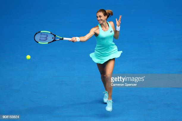 Elise Mertens of Belgium plays a forehand in her fourth round match against Petra Martic of Croatia on day seven of the 2018 Australian Open at...