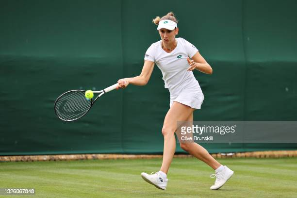 Elise Mertens of Belgium plays a forehand in her Ladies' Singles First Round match against Harriet Dart of Great Britain during Day Two of The...