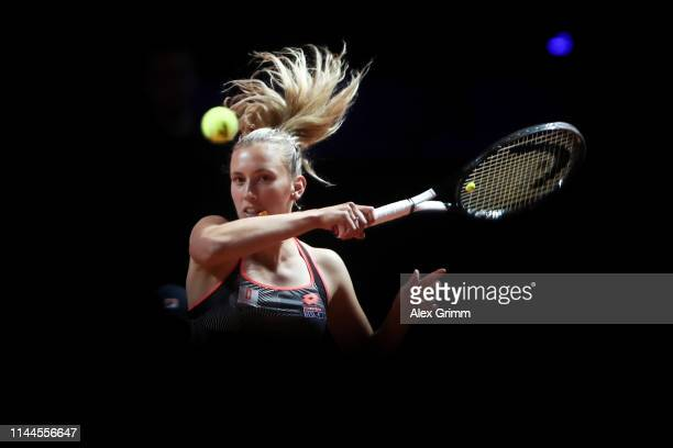 Elise Mertens of Belgium plays a forehand to Daria Kasatkina of Russia during their first round match on day 2 of the Porsche Tennis Grand Prix at...