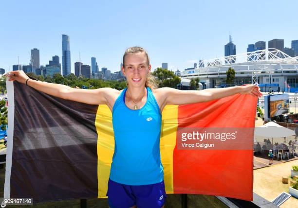 Elise Mertens of Belgium poses with the Belgian flag on day ten of the 2018 Australian Open at Melbourne Park on January 23 2018 in Melbourne...