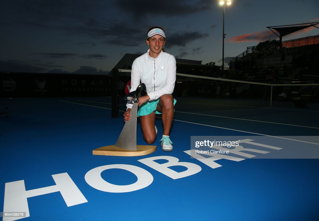 Elise Mertens of Belgium poses with the winner's trophy after she defeated Mihaela Buzarnescu of Romania during the 2018 Hobart International at Domain Tennis Centre on January 13, 2018 in Hobart, Australia.