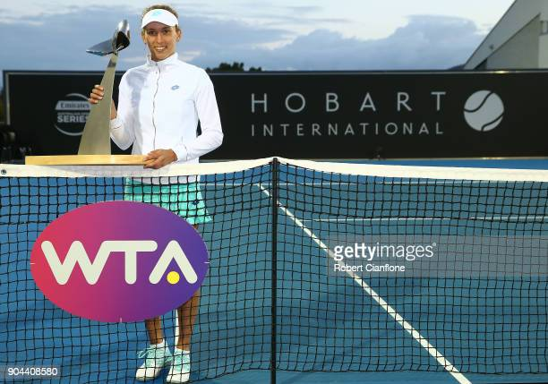 Elise Mertens of Belgium poses with the winner's trophy after she defeated Mihaela Buzarnescu of Romania during the 2018 Hobart International at...