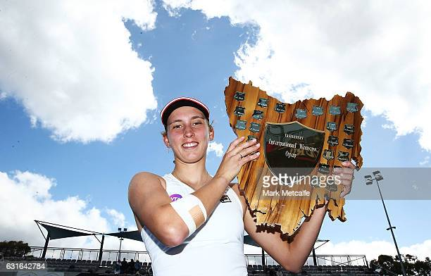 Elise Mertens of Belgium poses with the winners trophy after victory in her singles final match against Monica Niculescu of Romania during the 2017...