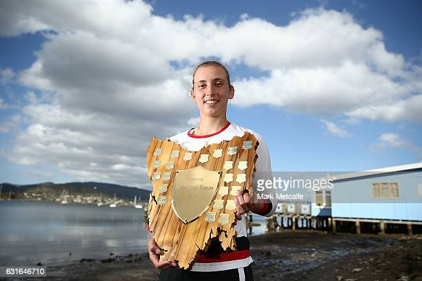 Elise Mertens of Belgium poses with the winners trophy at Cornelian Bay after victory in her singles final match against Monica Niculescu of Romania...