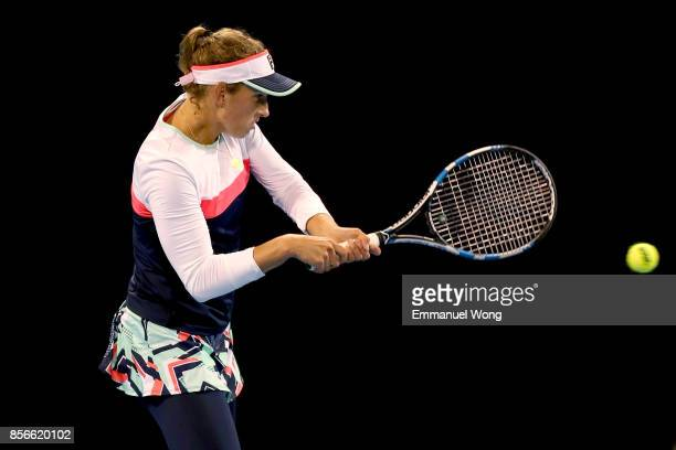 Elise Mertens of Belgium returns a shot against Dominika Cibulkova of Slovakia on day three of the 2017 China Open at the China National Tennis...
