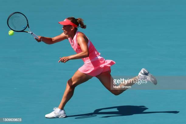 Elise Mertens of Belgium returns a shot during her women's singles third round match against Anett Kontaveit of Estonia on Day 7 of the 2021 Miami...