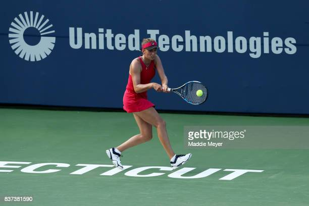 Elise Mertens of Belgium returns a shot to Daria Kasatkina of Russia during Day 5 of the Connecticut Open at Connecticut Tennis Center at Yale on...