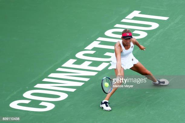 Elise Mertens of Belgium returns a shot to Dominika Cibulkova of Slovakia during Day 7 of the Connecticut Open at Connecticut Tennis Center at Yale...