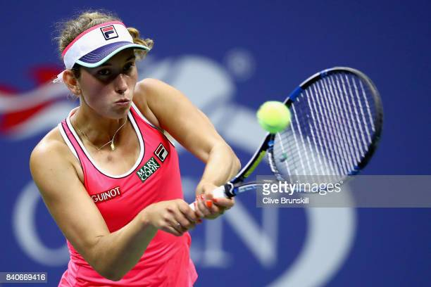 Elise Mertens of Belgium returns a shot to Madison Keys of the United States on Day Two of the 2017 US Open at the USTA Billie Jean King National...