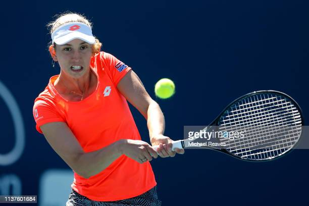 Elise Mertens of Belgium returns a shot to Pauline Parmentier of France during Day 5 of the Miami Open Presented by Itau at Hard Rock Stadium on...