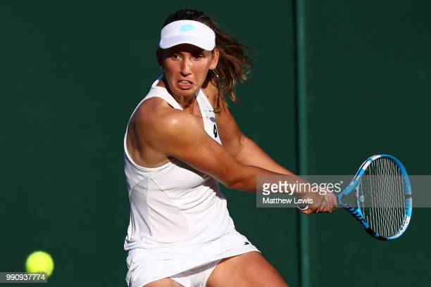Elise Mertens of Belgium returns against Danielle Collins of The United States on day two of the Wimbledon Lawn Tennis Championships at All England...
