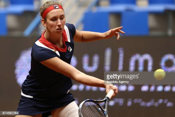 Elise Mertens of Belgium returns the ball during the TEB BNP Paribas Istanbul Cup Women's Couple tennis match between Cagla Buyukakcay of Turkey...