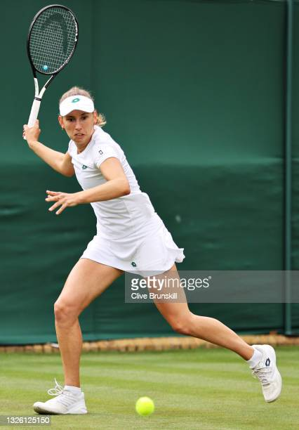 Elise Mertens of Belgium runs to play a forehand in her Ladies' Singles First Round match against Harriet Dart of Great Britain during Day Two of The...