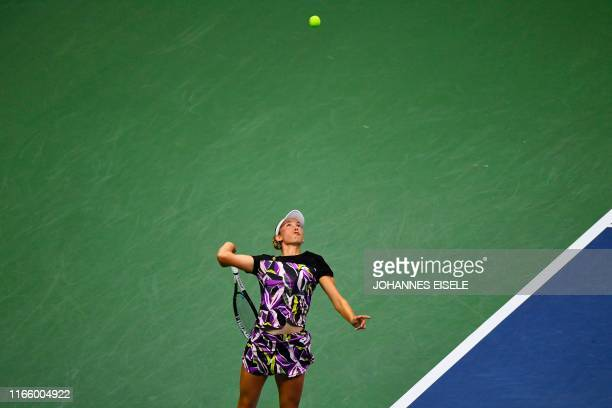 TOPSHOT Elise Mertens of Belgium serves against Bianca Andreescu of Canada during their Women's Singles Quarterfinals match at the 2019 US Open at...