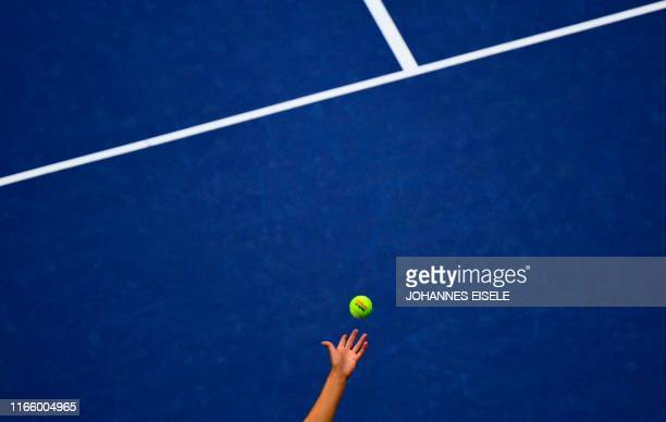 Elise Mertens of Belgium serves against Bianca Andreescu of Canada during their Women's Singles Quarterfinals match at the 2019 US Open at the USTA...