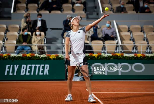 Elise Mertens of Belgium serves against Caroline Garcia of France in the third round of the women's singles at Roland Garros on October 02, 2020 in...
