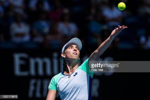 Elise Mertens of Belgium serves in her fourth round match against Simona Halep of Romania on day eight of the 2020 Australian Open at Melbourne Park...