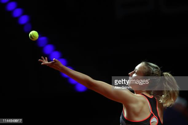 Elise Mertens of Belgium serves the ball to Daria Kasatkina of Russia during their first round match on day 2 of the Porsche Tennis Grand Prix at...