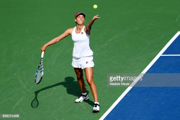 Elise Mertens of Belgium serves to Dominika Cibulkova of Slovakia during Day 7 of the Connecticut Open at Connecticut Tennis Center at Yale on August...