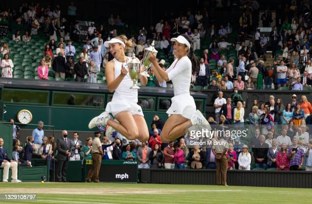 Elise Mertens of Belguim and Su-Wei Hsieh of Chinese Taipei celebrate with their trophies after winning the Ladies doubles after defeating Veronica...