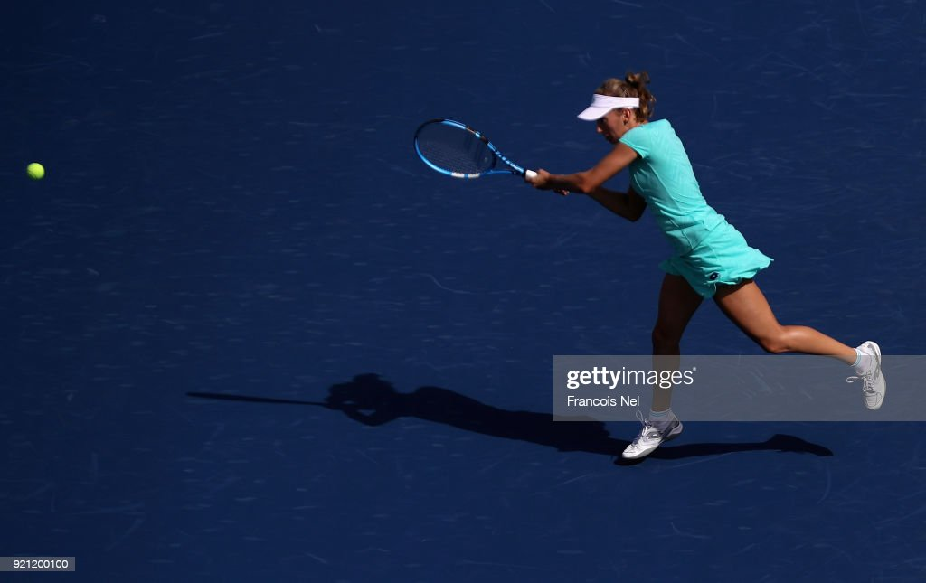 Elise Mertens of Belguim in action against Catherine Bellis of USA during day two of the WTA Dubai Duty Free Tennis Championship at the Dubai Tennis Stadium on February 20, 2018 in Dubai, United Arab Emirates.
