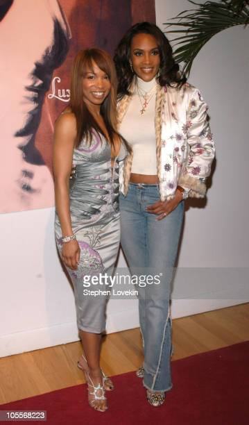 Elise Neal and Vivica A Fox during Olympus Fashion Week Fall 2005 Luxe Romance Front Row at The Altman Building in New York City New York United...