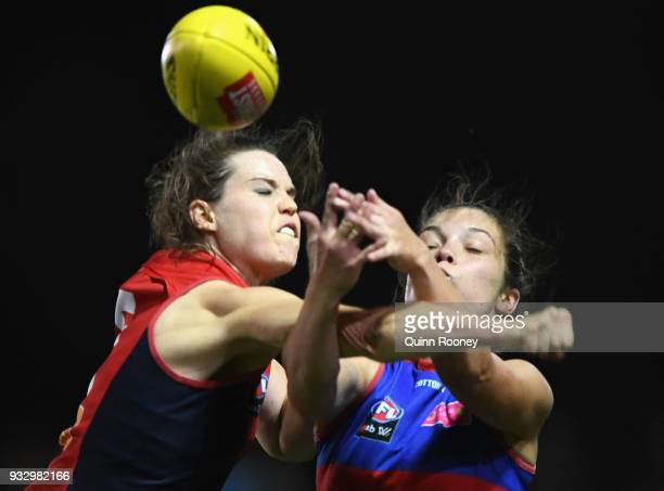 Elise OÕDea of the Demons spoils a mark by Ellie Blackburn of the Bulldogs during the round seven AFLW match between the Western Bulldogs and the...