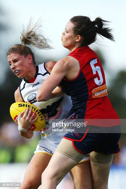 Elise O'Dea of the Demons tackles Talia Radan of the Crows during the round two AFLW match between the Melbourne Demons and the Adelaide Crows at...
