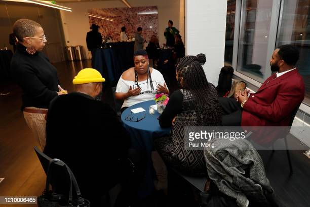 Elise Perry Grammys DC Chapter Board Member Kokayi RA Board Member Anshia Crooms and NFL Kansas City Chiefs player Anthony Lanier II and Poet attend...
