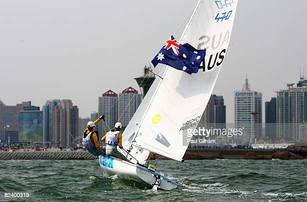 Elise Rechichi and Tessa Parkinson of Australia celebrate overall victory following the Women's 470 class medal race held at the Qingdao Olympic...