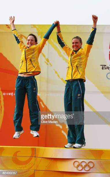 Elise Rechichi and Tessa Parkinson of Australia celebrate winning the Women's 470 class event held at the Qingdao Olympic Sailing Center during day...