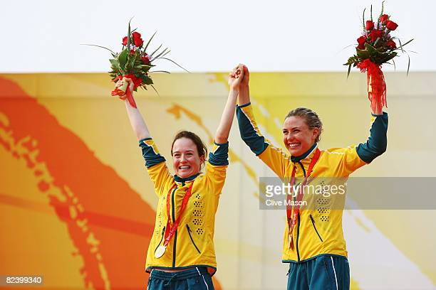 Elise Rechichi and Tessa Parkinson of Australia celebrate with their gold medals after winning the Women's 470 class event held at the Qingdao...