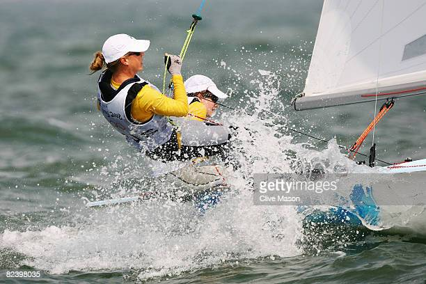 Elise Rechichi and Tessa Parkinson of Australia compete on their way to overall victory in the Women's 470 class medal race held at the Qingdao...