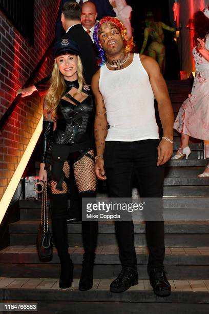 Elise Tate and Golden Tate attend Heidi Klum's 20th Annual Halloween Party presented by Amazon Prime Video and SVEDKA Vodka at Cathédrale New York on...