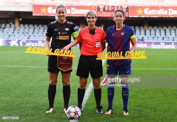 Elise Thorsnes of Avakdsnes and Vicky Losada of FC Barcelona pose with the referee Graziella Pirriatore prior to the UEFA Womens Champions League...